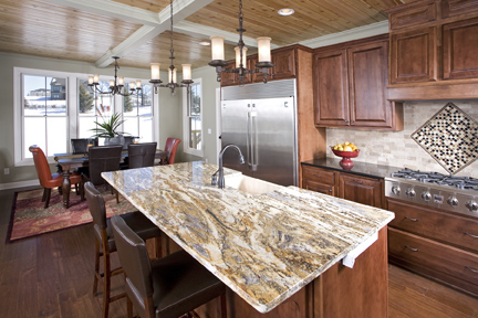 Hurricane Gold Granite At Island With Glass Tile Insert To