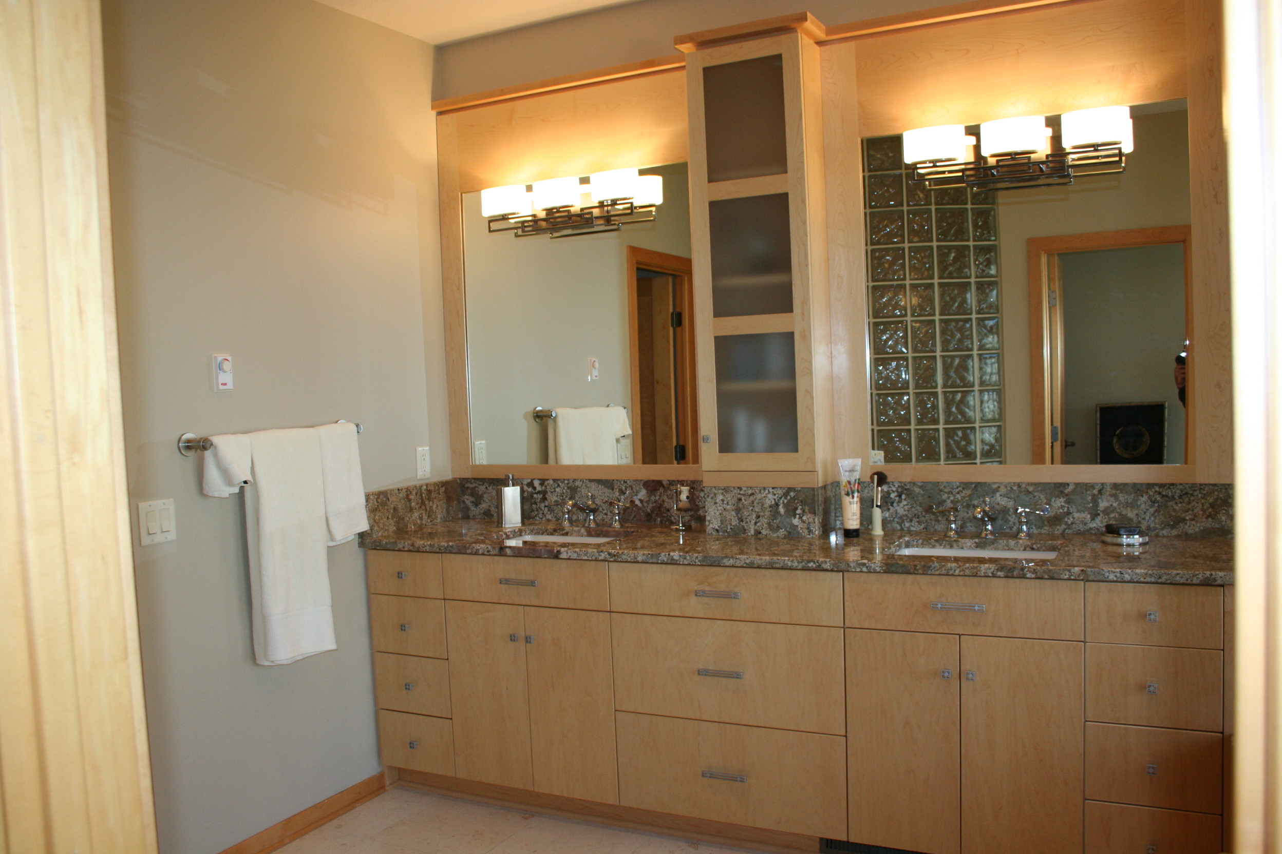 i love the look of the pompeii granite here as well as the kohler ladena sinks a personal favorite the frame around the mirrors is completely custom to - Kohler Ladena